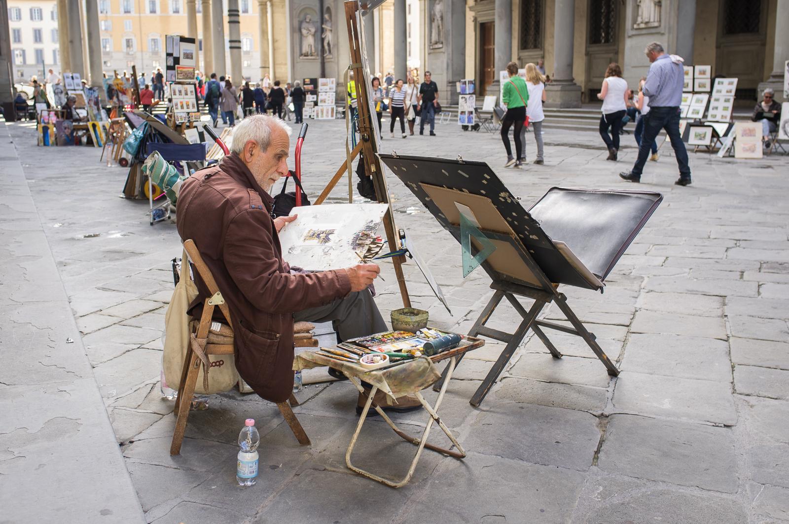 Artist at work near Galleria degli Uffizi