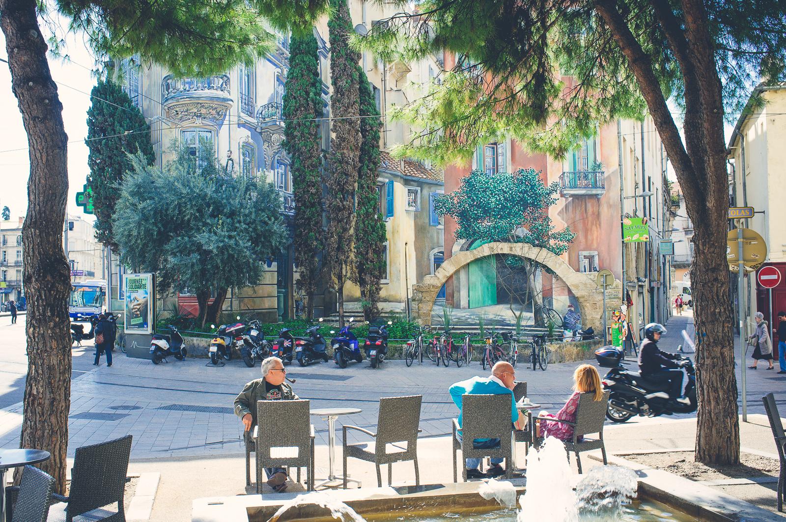 Trompe l'oeil wall painting (Place Alexandre Laissac)